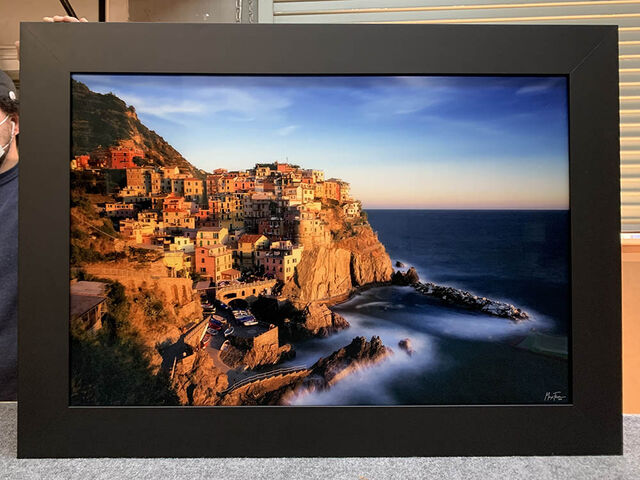 A 24x36 Gallery Ultra+ Trulife Acrylic Print of Manarola Gold with a Ramino Black frame (no liner).