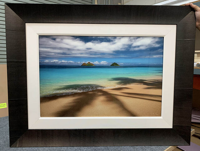 A 20x30 Gallery Ultra+ Trulife Acrylic Print of Palm Trees & Daydreams with a Tabacchino Dark Ash frame and white liner.