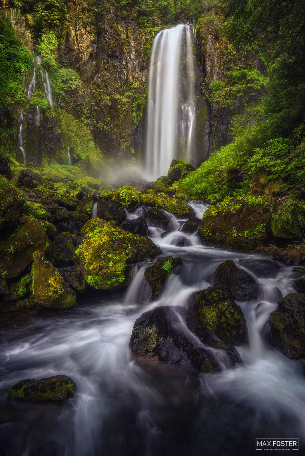 Fine Art Limited Edition of 50 A waterfall is an area where water flows over a vertical drop or a series of steep drops in the...